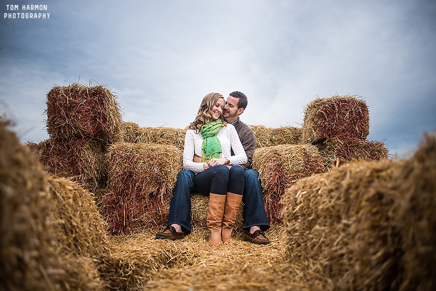 engagement session on hay bails